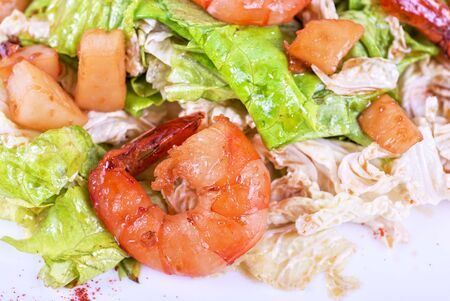 Salad with tiger shrimps and vegetable closeup photo
