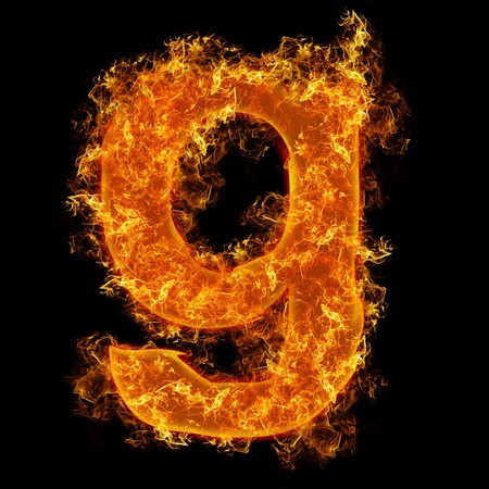 tongues of fire: Fire small letter G on a black background Stock Photo