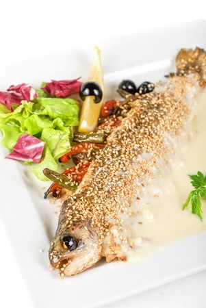 trout fish baked with greens closeup Stock Photo - 7608638
