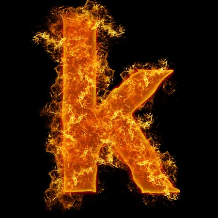 Fire small letter K on a black background Stock Photo - 7608641