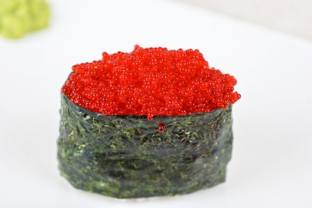 Red tobiko (flying fish roe) sushi closeup photo