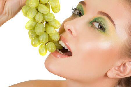 Pretty young woman with grape on the white background photo