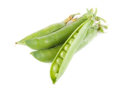Ripe pea vegetable with green leaf isolated on white background Stock Photo - 7649352