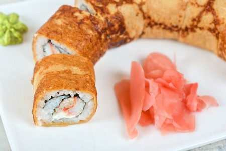 Sushi - made of crab meat, cheese, pancake outside photo