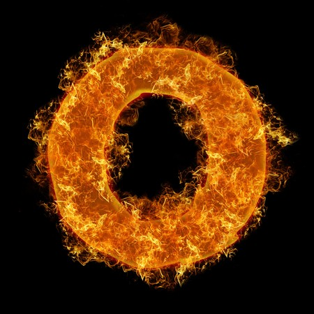 Fire small letter O on a black background photo