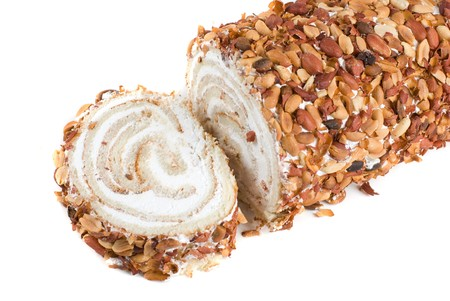 Nuts Swiss roll closeup isolated on a white background photo