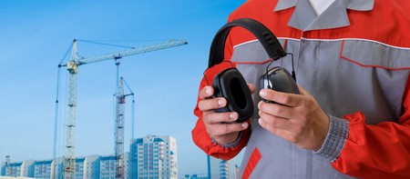 protective headphone at man hands on building background Stock Photo - 7649404