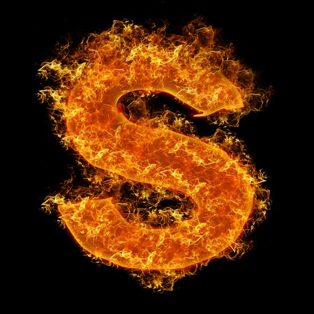 engulfed: Fire small letter S on a black background Stock Photo