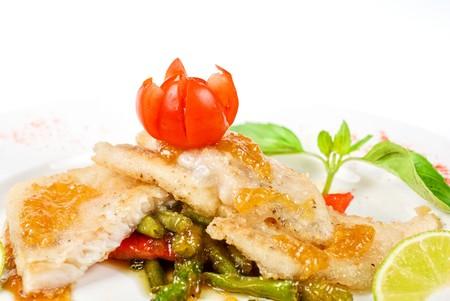 halibut filet roast at lime juice and vegetables photo