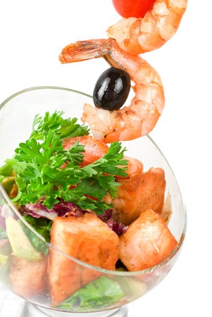 Fried kebab of shrimps with vegetables, greens and salmon fish