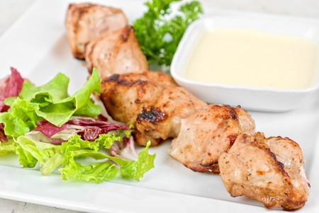 Fried kebab meat with vegetables and sauce photo
