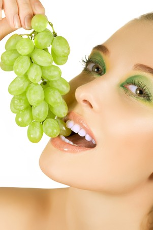 Pretty young woman closeup with grape on the white background