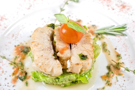 Salad of roasted filet pikeperch with courgette and aubergine, and cherry tomato photo
