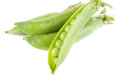 Ripe pea vegetable with green leaf isolated on white background Stock Photo - 7699768