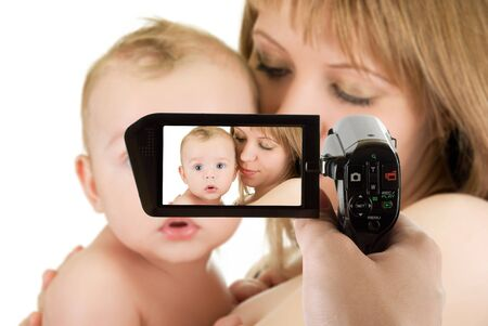 camcorder: Happy maternity: mother with her baby boy isolated on a white at camcorder Stock Photo
