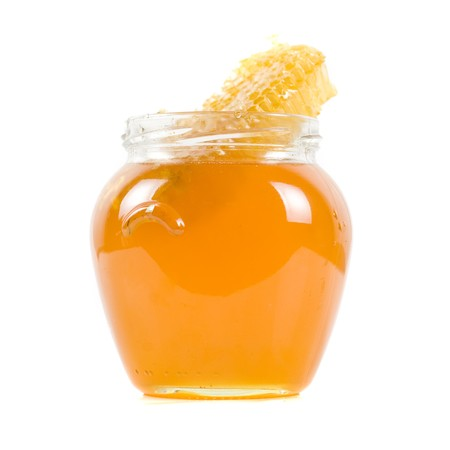 jar of organic honey on white background photo
