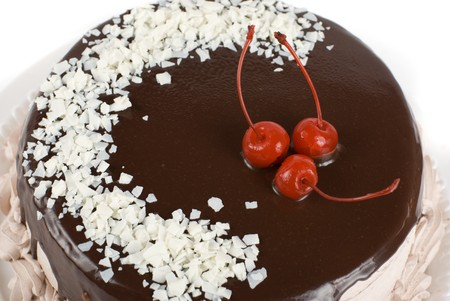 torte: cake closeup with cherry isolated on a white