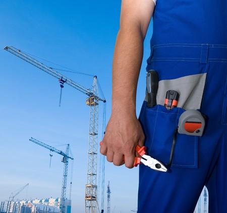 alicate: Detalle de reparador con pinzas en la creaci�n de fondo