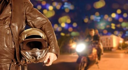 motor show: Biker closeup at night city background Stock Photo