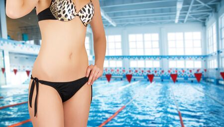 girl at bikini closeup on at swimming pool background photo