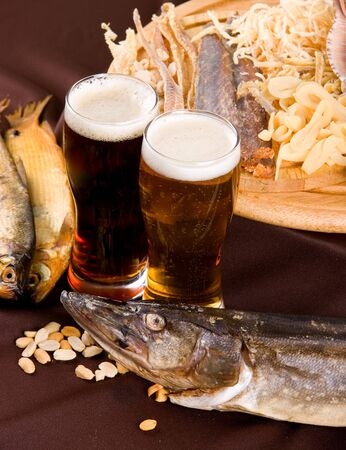Beer and snacks set: chips, pistachio, shrimp and fish Stock Photo - 7699918