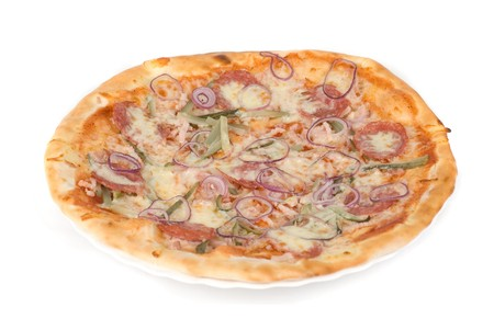 pizza closeup with smoked meat, salami, gherkin, onion and mozzarella cheese photo