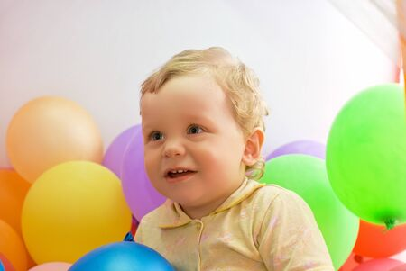 cute baby boy with colorful balloons photo