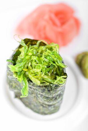 Japanese fresh maki sushi with green seaweed photo