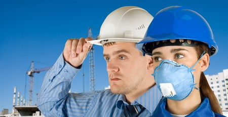 Portrait of young architects at in front of construction site, building and crane. Stock Photo - 7816348