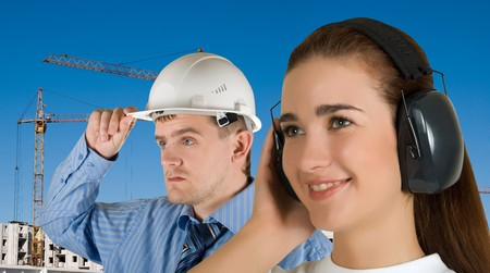 Portrait of young architects at in front of construction site, building and crane. Stock Photo - 7816188