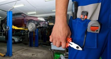 Auto mechanic closeup standing in his workshop 写真素材