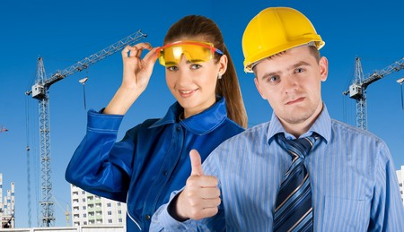 Portrait of young architects at in front of construction site, building and crane. Stock Photo - 7854302