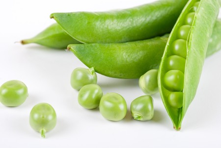Ripe pea vegetable with green leaf isolated on white background Stock Photo - 7943739