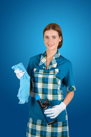 girl cleaner at uniform isolated on a blue photo