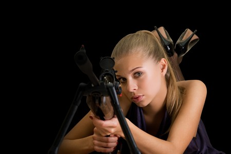 Beauty blond girl with a gun on a black background Stock Photo - 7940520