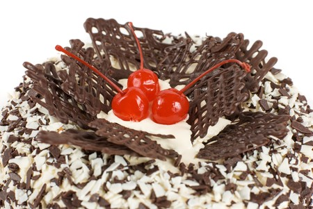 chocolate cake with berry isolated on a white photo