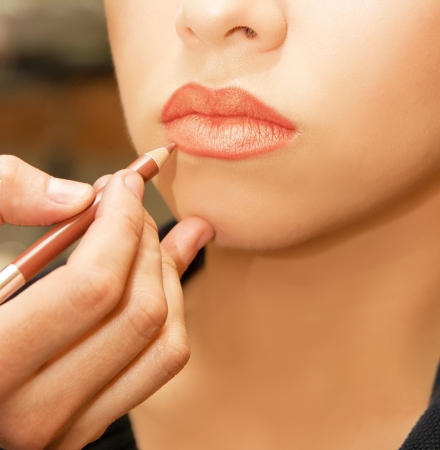 sexy lips: Applying lips contour closeup