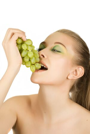 Pretty young woman with grape on the white background Stock Photo - 8006866