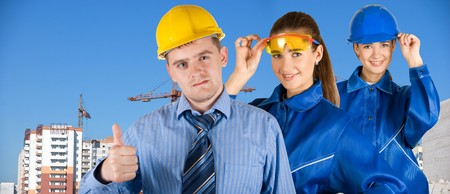 Portrait of architects at in front of construction site, building and crane. Stock Photo - 8006875