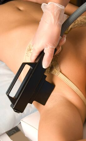 armpit laser epilation of leg in a modern beauty shop photo