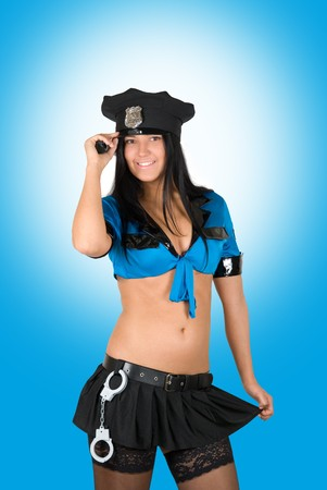 sexy policewoman on a blue background Stock Photo - 8080662