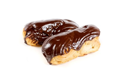 Chocolate Cream eclairs isolated on a white background photo