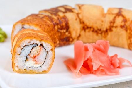 Sushi - made of crab meat, cheese, omelette outside photo