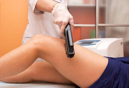 Laser epilation of leg in a modern beauty shop Stock Photo - 8138760