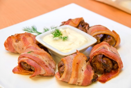 tasty rolls of bacon and chicken liver photo