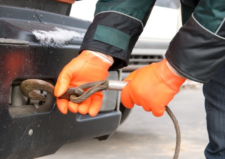 Man hands closeup with towing cable photo