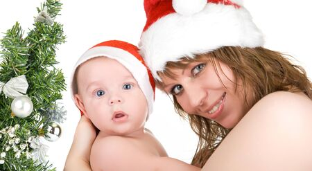 Beautiful mommy santa and her baby Santa boy on a white photo