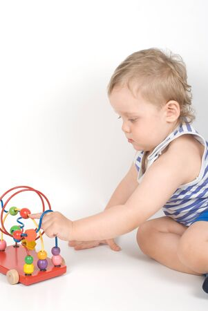 Small baby with a toy Stock Photo - 8267165