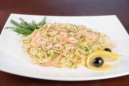 Pasta with shrimps lemon and olive - tasty dish photo