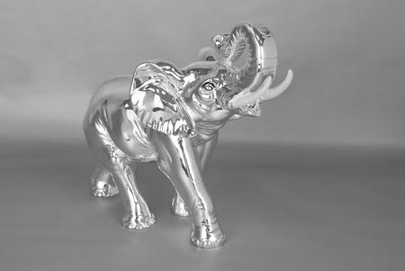 Silver jewelry elephant on a grey photo